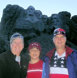 David Bancroft pictured with his wife and grandson at Mount Rushmore