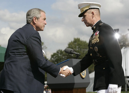 President George W. Bush and outgoing Joint Chiefs of Staff Chairman U.S. Marine General Peter Pace shake hands during the Armed Forces farewell tribute in honor of General Pace and the Armed Forces hail in honor of the new Joint Chiefs of Staff Chairman Navy Admiral Michael Mullen, Monday, October 1, 2007 at Fort Myer, Virginia. General Pace is retiring after serving two years as chairman and 40 years in the U.S. Marines.