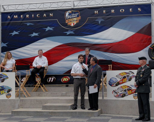 NASCAR driver Jeff Gordon speaks to the crowd during the unveiling ceremonies at Lowe's Motor Speedway in recognition of 'American Heroes Memorial Day salute to the Armed Forces' at the Lowe's Motor Speedway in Charlotte, N.C., May 8, 2007.