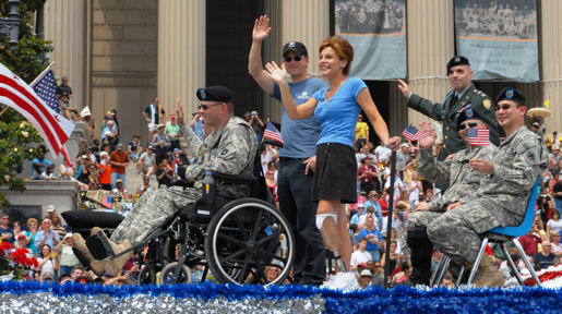 Hollywood actor Gary Sinise and the wounded warriors serving as Grand Marshals of the National Memorial Day Parade in Washington, D.C. May 28, 2007, wave as they pass the reviewing stand.