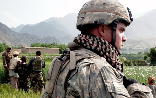 U.S. Army 1st Lt. Tyler Sweat, an Alpha Company, 3rd Brigade Special Troops Battalion platoon leader, watches the horizon as Afghan National Army soldiers question a man during a patrol, May 3, 2007.
