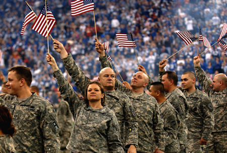 U.S. Army soldiers from Army Recruiting Command, Camp Atterbury, Ind., and members of the Indiana Army National Guard show support during the NFL playoff game in Indianapolis, Jan. 6, 2007.