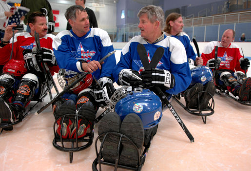 Secretary of Veterans Affairs R. James Nicholson, right, takes a moment to talk to a fellow player after a game of sled hockey during the National Disabled Veterans Winter Sports Clinic in Snowmass Village, Colo. April 3, 2007.