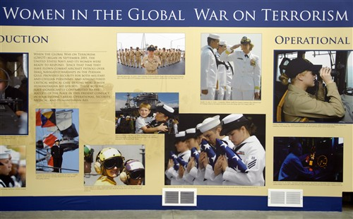 A display highlighting military women's contributions in the war on terrorism stands in the hall of the Women's Memorial at Arlington National Cemetery, Nov. 3, 2007.