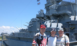 David Bancroft with his wife and grandson with USS Alabama in background