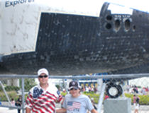 David Bancroft with grandson in front of space shuttle Explorer