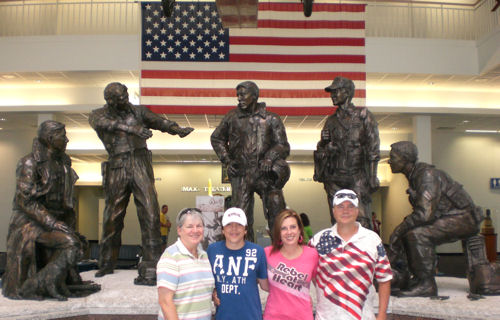 David Bancroft with his wife, daughter, and grandson in front of statues of naval aviators from each war at the National Naval Aviation Museum in Pensacola, FL (June 2008).