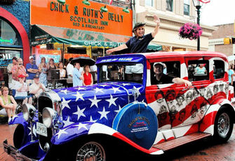 Ted Levitt, owner of Chick and Ruth's Delly in Annapolis, Md., debuts his Faces of Valor USA project during the town's Fourth of July Parade.