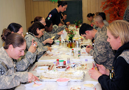 Multinational Division Baghdad soldiers gathered at the Ironhorse Oasis Dining Facility here Dec. 21 to celebrate Christmas in a traditional way by decorating Christmas cookies.