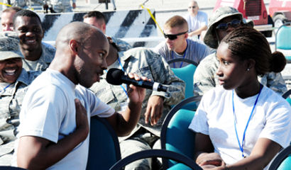"Senior Airman Demetrius Johnson sings Rod Stewart's ""Have I Told You Lately That I Love You"" to Airman 1st Class Ashley Jackson during a July 10, 2009 show at Manas Air Base, Kyrgyzstan. Airman Johnson is a Tops In Blue vocalist, and Airman Jackson is assigned to the 2nd Logistics Readiness Squadron."