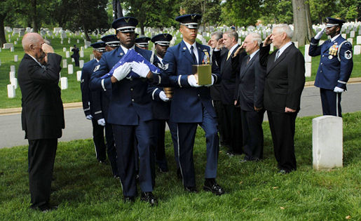U.S. Air Force Honor Guard members position the remains of Chief Master Sergeant Paul W. Airey while former Chief Master Sergeant's of the Air Force render salutes during the memorial service at Arlington National Cemetery, Va., May 28, 2009. Chief Airey, serving 27 years, became the first Chief Master Sergeant of the Air Force April 3, 1967, following his installment by then Secretary of the Air Force Harold Brown and Air Force Chief of Staff Gen. John P. McConnell. Chief Airey retired from active duty on Aug. 1, 1970 and died March 11 in Panama City, Fla. Chief Airey and his wife Shirley's remains were buried together at Arlington National Cemetery