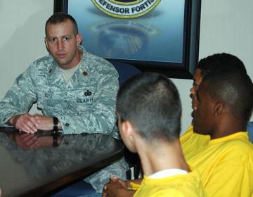 Maj. Woody Boyd talks to teenagers from the Liberty Juvenile Unit for Special Treatment facility about the mission of the 325th Security Forces Squadron May 5, 2009 at Tyndall Air Force Base, Fla. Airmen hosted the teens for a day, showed them the base and mentored the youths. Major Boyd is the 325th SFS commander.