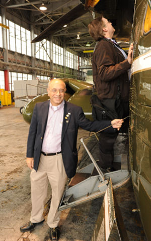 John D'Ambrosio, the president for Orange County, N.Y., Chamber of Commerce, takes poses in front of a CH-53 helicopter in a hanger at Marine Corps Air Facility Quantico. D'Ambrosio came with 24 other civic leaders from Newburgh, N.Y. to learn more about the Marine Corps.