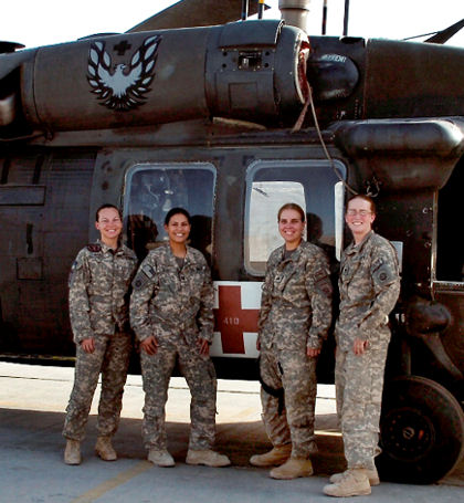 Female medevac crewmembers pose for a picture. They are, from left, Army Chief Warrant Officer Monica Narhi, maintenance test pilot; Army Capt. Jennie Richey, medevac pilot and company commander; Army Sgt. Christie Chaney, flight medic; and Army Spc. Nicole Hyde, crew chief.