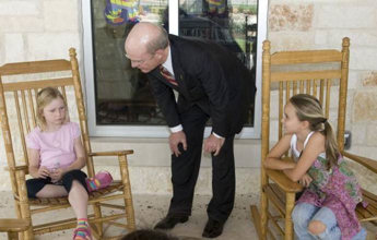 Army Secretary Pete Geren meets with Elizabeth Harris, left, and Abby Smith, children of wounded soldiers, April 29, 2009, during a visit to the Warrior Family Support Center, Fort Sam Houston, Texas, in observance of the Month of the Military Child. Geren applauded the contributions made by the children in supporting the recovery of their parents.