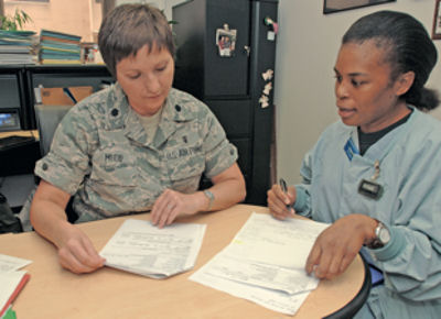 Lt. Col. Jacqueline Mudd (left) looks over flash sterilization data with Capt. Yvonne Storey July 22 at Lackland Air Force Base, Texas. Colonel Mudd was chosen the 2009 recipient of the Gen. Benjamin O. Davis Jr., Military Award by the Tuskegee Airmen Incorporated. Colonel Mudd is the operating room flight commander for the 59th Surgical Operations Squadron, and Captain Storey is an operating room nurse in the 59th SOS.