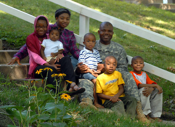 Chaplain (Maj.) Dawud Agbere and his family pose outside of their home in Normandy Village on Fort Leavenworth, Kan., Aug. 11, 2009.
