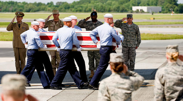 A U.S. Navy team transfers the remains of Petty Officer 2nd Class Tony M. Randolph at Dover Air Force Base, July 8, 2009, as Adm. Mike Mullen, chairman of the Joint Chiefs of Staff, joined Rear Adm. James J. Shannon, commander of the Naval Warfare Center, Army Brig. Gen. Michael T. Harrison Sr., director of Joint and Futures, Office of the Deputy Chief of Staff, G8, Headquarters, Department of the Army, Washington D.C., and Air Force Col. Manson O. Morris, commander, 436th Airlift Wing, Dover Air Force Base.