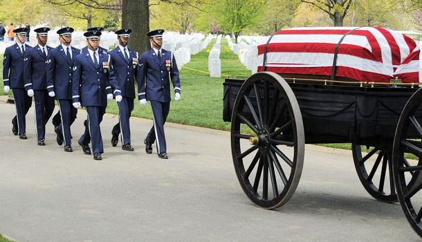 A United States Air Force Honor Guard body bearer team marches behind a caisson during a full-honors funeral ceremony at Arlington National Cemetery. Honor Guard body bearers train constantly to maintain the precision they are known for. Their standards of flawlessness are set out of necessity to honor fallen Airmen.