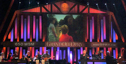 "John Conlee performing his patriotic hit song, ""They Also Serve"", at the Grand Ole Opry on July 4, 2009."