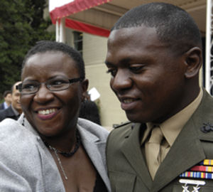 Marine Sgt. Tikonblah Dargbeh poses with his mother Martha Dargbeh following a Sept. 10, 2009 naturalization ceremony at the Pentagon in Washington, D.C., during which the Marine officially became a U.S. citizen.