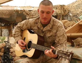Marine Corps Lance Cpl. Stephen D. Davis plays a song he wrote, June 17, 2009, at Camp Al Taqaddum, Iraq. Davis has been writing songs inspired by war veterans since he was 11.