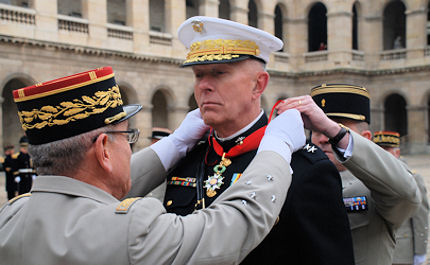 PARIS, France-Gen. James T. Conway, the 34th Commandant of the United States Marine Corps, is presented with France's National Order of the Legion of Honour during a military awards ceremony at the historic Les Invalides here Dec. 1. The Chief of Staff of the French Army Gen. Elrick Irastorza presented the award, which included a full military pageant, featuring platoons of French honor guardsman, a ceremonial band, and French and American military representatives.