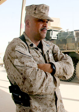 Marine Corps 1st Sgt. Viriato B. Sena stands before his Marines at Al Asad Air Base, Iraq, Oct. 13, 2009. Sena, who joined the Marine Corps in 1973, participated in the evacuation of Vietnam and is now deployed to Iraq for the drawdown of U.S. forces there.