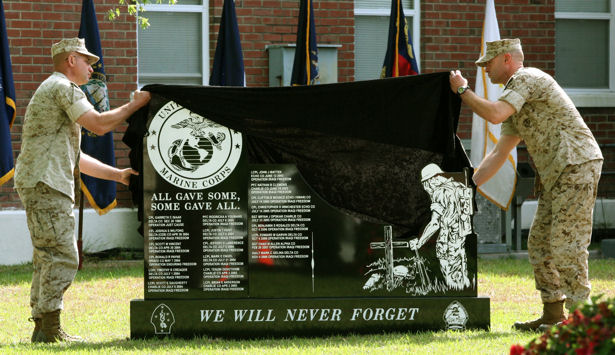 Sgt. Maj. Luke T. Converse, battalion sergeant major, and Lt. Col. Thomas E. Gratten, battalion commander, 2nd Light Armored Reconnaissance Battalion, 2nd Marine Division, unveil a granite memorial engraved with the names of 21 Marines who died in support of Operations Just Cause, Enduring Freedom and Iraqi Freedom. The memorial was unveiled the day before Marines from 2nd LAR deployed to Afghanistan as part of the 2nd Marine Expeditionary Brigade. Gratten said it was important before deployment to remember those who have fought before and the sacrifice they have made.