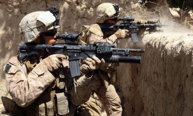 Hasaan Abad, Helmand , Afghanistan-Sgt. Ryan Pettit, left, and Cpl. Matthew Miller, from 2nd Battalion, 8th Marine Regiment, fire their service rifles during an operation in Helmand province, Afghanistan, July 3, 2009. The Marines are part of Regimental Combat Team 3, Marine Expeditionary Brigade-Afghanistan.