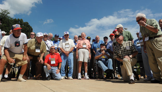 MARINE CORPS BASE QUANTICO, Va.-Approximately 70 of the surviving 300 Raiders pose for photos after honoring their Killed In Action at a dedication ceremony Aug. 20 at Raider Hall.