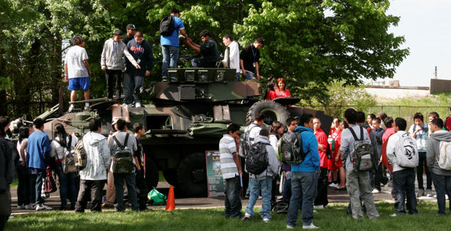 Marie Curie High School students got in and around the Marine Corps' Light Armored Vehicle-25A2 armored personnel carrier during a static display at Marie Curie High School May 11. The static display at Chicago's second largest high school was one of the first events of the inaugural Marine Week Chicago. Marine Week Chicago, which runs from May 11-17, is an opportunity for Chicago citizens to meet the men and women of the Marine Corps and learn about its history, traditions and value to the nation.