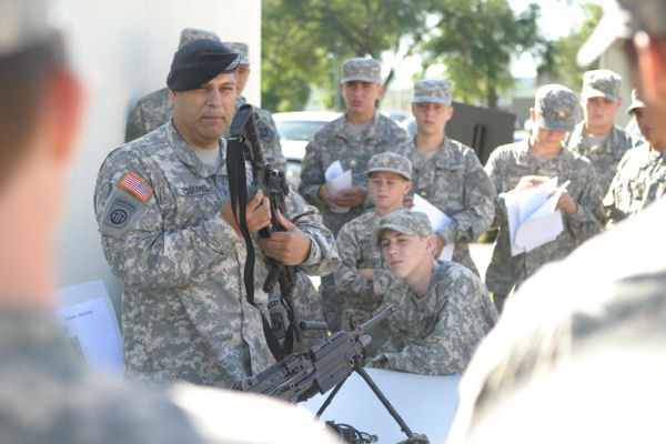 Cadets from St. John's Military School, Salina, Kan., learn about small arms from a Soldier with 1st Battalion, 16th Infantry Regiment, 1st Brigade at Fort Riley on August 26. 2009.