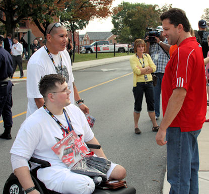 NASCAR driver and owner Tony Stewart (red shirt) shakes hands and thanks Walter Reed Army Medical Center patient Spc. Kenneth Parker, 25, for his service and sacrifice Sept. 24, 2009.