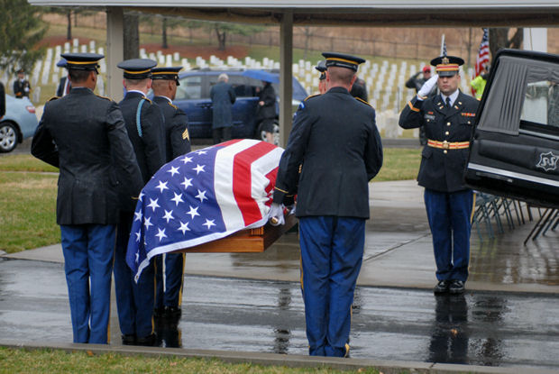 Members of the New York Military Forces Honor Guard move the casket containing the remains of Army Sgt. Dougall Espey from a hearse during his burial in Woodlawn National Cemetery on April 3. Espey was killed in Korea in November 1950 and his remains were identified in 2008. He was buried on what would have been his 80th birthday.