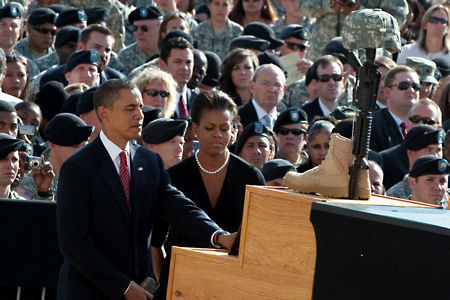 Taking part in a Nov. 10, 2009, memorial service on Fort Hood, Texas, President Barack Obama and First Lady Michelle Obama look at the photograph of one of the victims of the Nov. 5 shooting rampage that left 13 dead and 38 wounded.