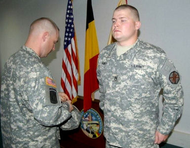 Army Staff Sgt. Jonathan James is promoted during a ceremony at U.S. Army Garrison Brussels, Belgium, where the noncommissioned officer is known for his accomplishments.