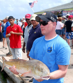 Army Spc. Ross Pelto holds a 37-inch red drum he caught while fishing during the Warrior's Weekend in Port O'Connor Texas, May 17, 2009.