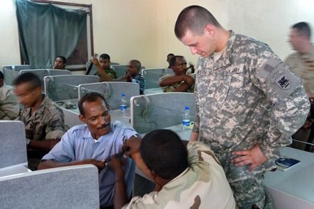 Army Pfc. Daniel Bateson mentors students from Djibouti's military during a five-day course that included classroom instruction, hands-on exercises and a day-long test of the skills in a simulated hostile environment.