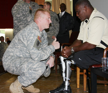Lt. Col. Greg Gadson, who lost both legs in an IED attack in Iraq in 2007, shares a moment with fellow artilleryman, Capt. David Evetts, commander of Battery D, 1st Battalion, 77th Field Artillery Regiment, at the Ledward Theater, Sept. 29, 2009.