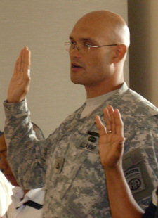 Army Pfc. Wenderson Jangada raises his right hand to become a U.S. citizen May 22, 2009, in Raleigh, N.C. Jangada, who speaks six languages, is from Brazil.