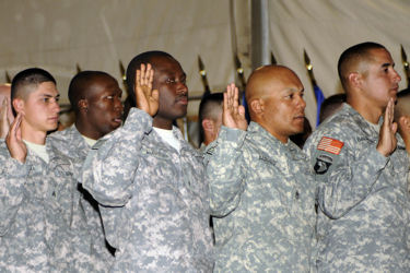 Servicemembers celebrate their first Memorial Day as U.S. citizens at a naturalization ceremony, May 25, 2009 at Bagram Air Field, Afghanistan.