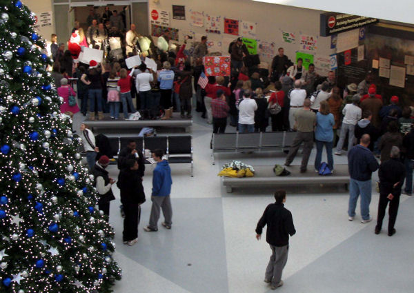 Holiday spirit and patriotism were both on full display at Baltimore-Washington International Thurgood Marshall Airport on Dec. 23, 2009, as hundreds of well-wishers gathered to welcome troops returning home from deployments just in time for the holidays.