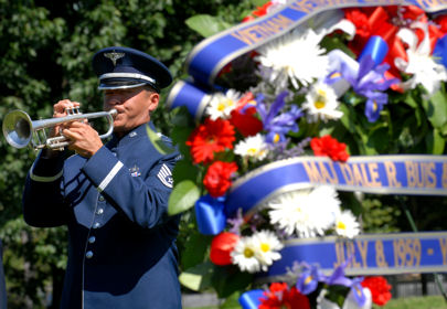 A U.S. Air Force bugler plays taps at a ceremony in Washington, D.C., July 8, 2009, in honor of the 50th Anniversary of the first two U.S. servicemembers killed in the Vietnam War. U.S. Army Master Sgt. Chester Ovnand and Maj. Dale Buis were killed at their base camp in Bien Hoa, just north of Saigon, Vietnam.