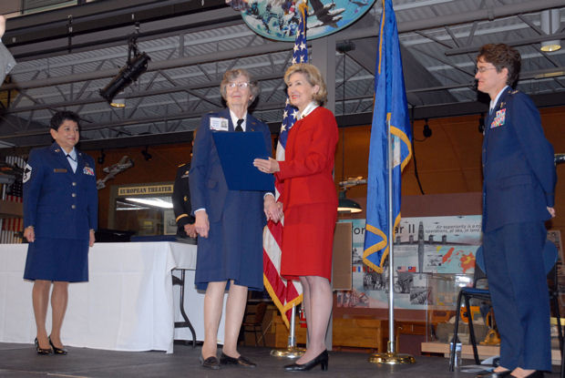 Sen. Kay Bailey Hutchison presents Betty Jo Streff Reed, a former Women Airforce Service Pilot, with a commemorative copy of Bill 111-40, which was passed by Congress to award the WASP a Congressional Gold Medal, the highest honor Congress can bestow a civilian for service to their country, Nov. 11, 2009, in Dallas. Col. Jacqueline Van Ovost, the 12th Flying Training Wing commander and guest speaker, looked on.