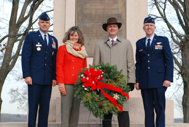 Members of the Wright family and Wright-Patterson Air Force Base, Ohio, placed a wreath at the Wright Brothers Memorial Dec. 17, 2009, during a ceremony marking the 106th anniversary of the Wright brothers' first powered flight. Amanda Wright Lane, great grand-niece of the brothers and Stephen Wright, great grand-nephew, pose with Col. Brad Spacy (left) and Brig. Gen. Paul Sampson. Colonel Spacy is 88th Air Base Wing commander and General Sampson is mobilization assistant to the commander of Aeronautical Systems Center.
