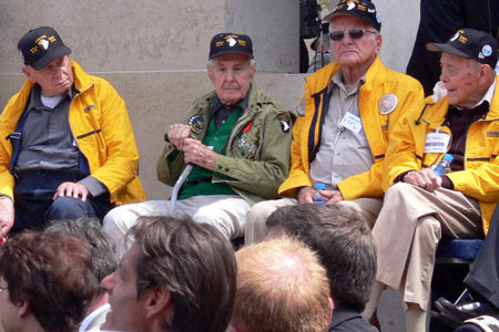 Surviving members of the famed Easy Company, 2nd Battalion, 506th Parachute Infantry Regiment, participate in a ceremony honoring the 65th anniversary of D-Day, at the Normandy American Cemetery and Memorial, June 6. The group was part of more than two dozen D-Day veterans honored in ceremonies across the Normandy region.