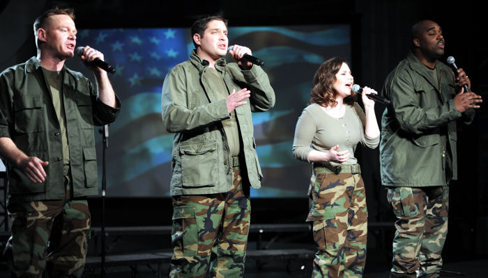 4TROOPS vocalists Daniel Jens, David Clemo, Meredith Melcher and Ron Henry perform aboard the USS Intrepid in New York City during the March 15, 2010 taping of a PBS television special to be aired in June.