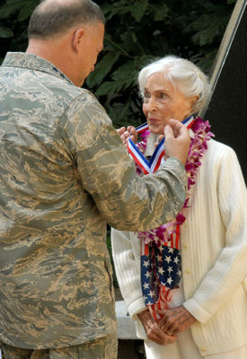 "Gen. Gary North presents a medallion to Doris Avery, a member of the ""Greatest Generation"" to honor her efforts in World War II Feb. 5, 2010, at Joint Base Pearl Harbor Hickam, Hawaii. General North presented the Noncommissioned Officers' Association World War II Veterans Medallion to Mrs. Avery for her heroic efforts. General North is the Pacific Air Forces commander."