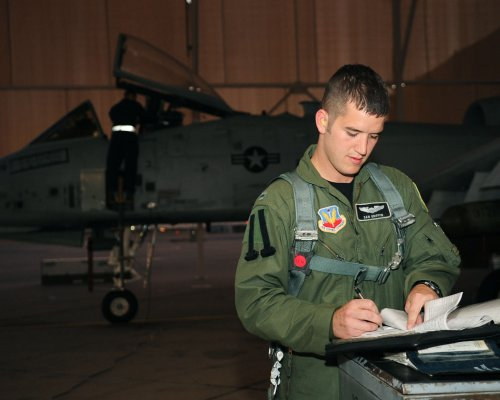 Prior to a training flight June 23, 2010, 1st Lt. Dan Griffin, a pilot from the 358th Fighter Squadron at Davis-Monthan Air Force Base, Ariz., reviews maintenance records for the A-10C Thunderbolt II he?ll be flying. This was the lieutenant's second of eight night flying missions as part of the A-10C Pilot Initial Qualification course curriculum. Upon completion of this course he will be a fully qualified A-10C pilot. U.S. Air Force photo by Airman 1st Class Jerilyn Quintanilla